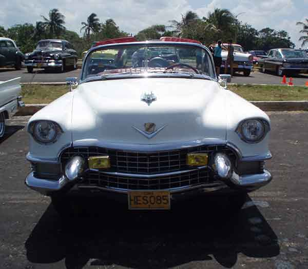White 1958 convertible Cadillac in Havana, Cuba. Front View